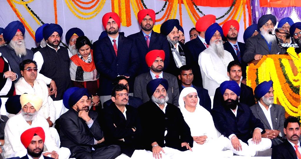 Sri Muktsar Sahib: Punjab Chief Minister Parkash Singh Badal addresses  during a Shiromani Akali Dal conference in Sri Muktsar Sahib of Punjab on Jan 14, 2015. Also seen  Punjab Deputy Chief Minister - Parkash Singh Badal and Sukhbir Singh Badal