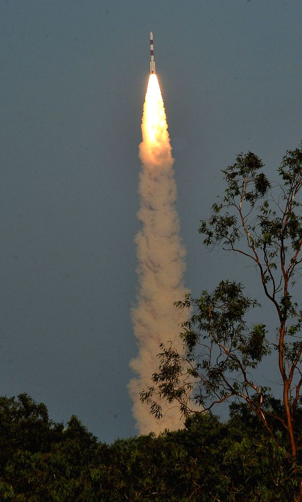 Indian Space Research Organisation`s Polar Satellite Launch Vehicle (PSLV-C27) carrying India`s fourth navigation satellite IRNSS-1D, lifts off from Satish Dhawan Space Center in ...