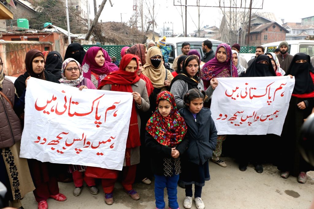Srinagar: A group of Pakistani women married to former Kashmiri militants, along with their children, stage a demonstration to urge Indian Prime Minister Narendra Modi to send them back to Pakistan; in Srinagar, on  Feb 2, 2019. (Photo: IANS) - Narendra Modi