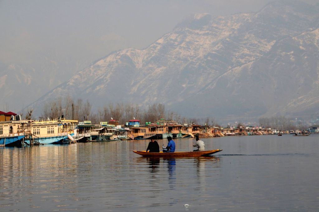 Srinagar: Boatmen row their boat through the serene waters of Jhelum river on a bright, sunny winter afternoon in Srinagar on Jan 14, 2019. (Photo: IANS)