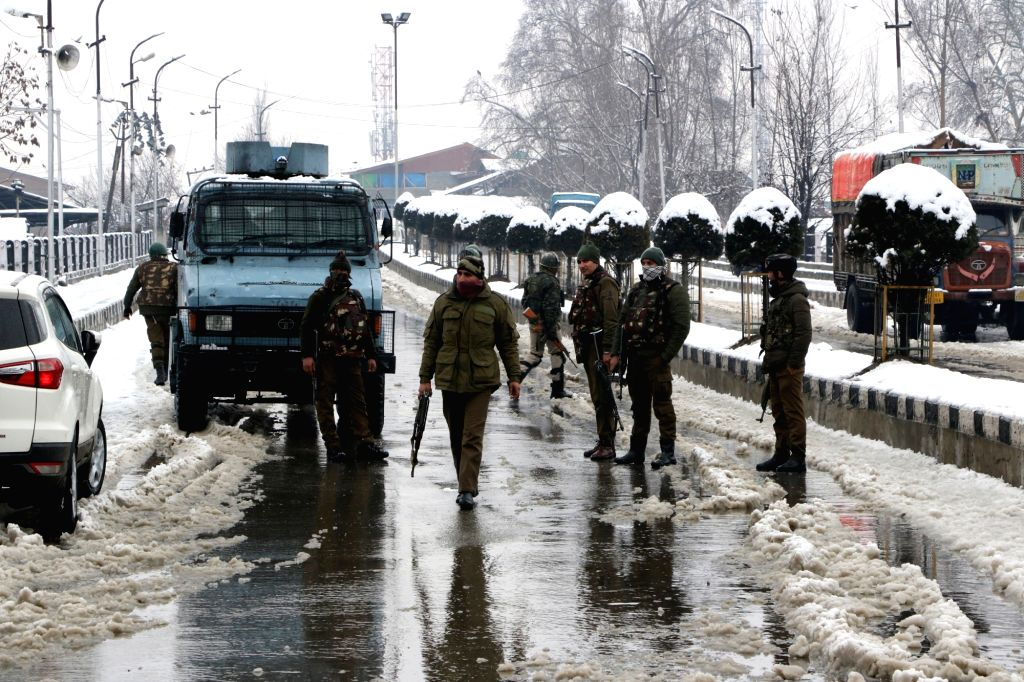 :Srinagar: CRPF personnel during search operations in Srinagar on Feb 12, 2018. An alert sentry at a Central Reserve Police Force (CRPF) camp here in Jammu and Kashmir on Monday averted a possible ...