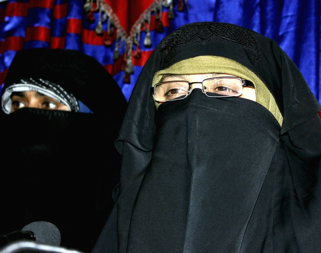Srinagar: Dukhtaran-e-Millat chief Aasiya Andrabi, who was booked under the Unlawful Activities Prevention Act for allegedly hoisting a Pakistani flag, on March 25, 2015. (File Photo: IANS)