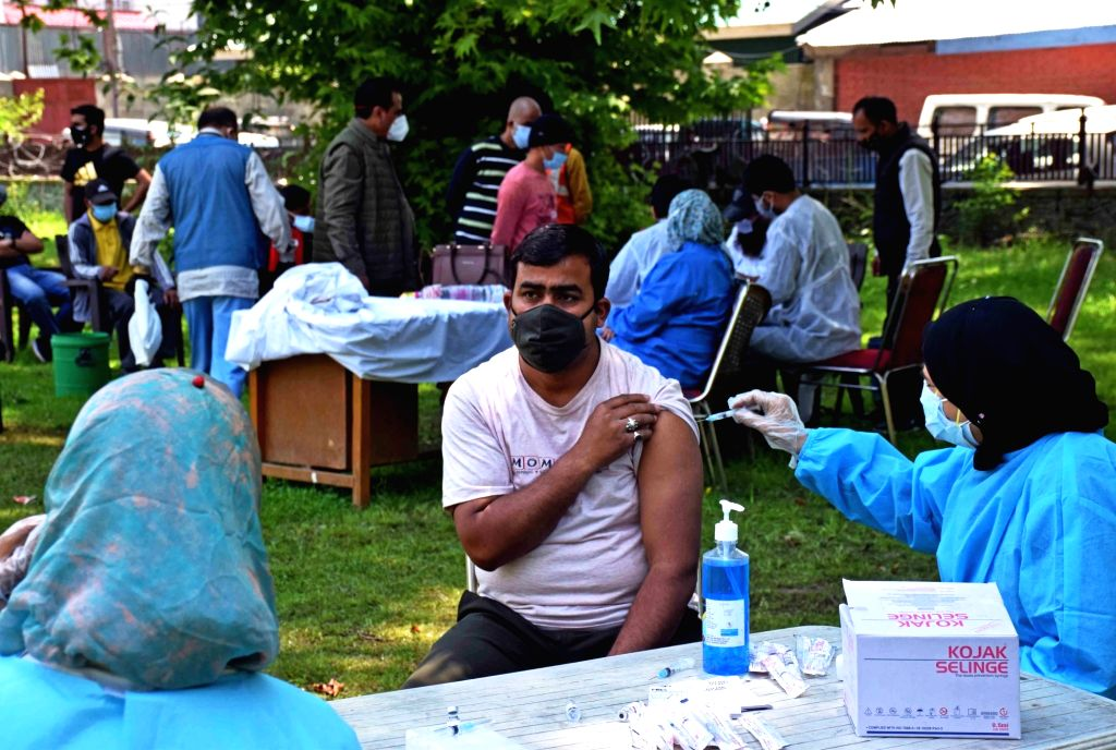 Srinagar: General Public Receiving Covid Vaccination Jab at Sheri Kashmir Park Srinagar on Wednesday, 26 May, 2021..(Photo: Nissar Malik/IANS) - Malik