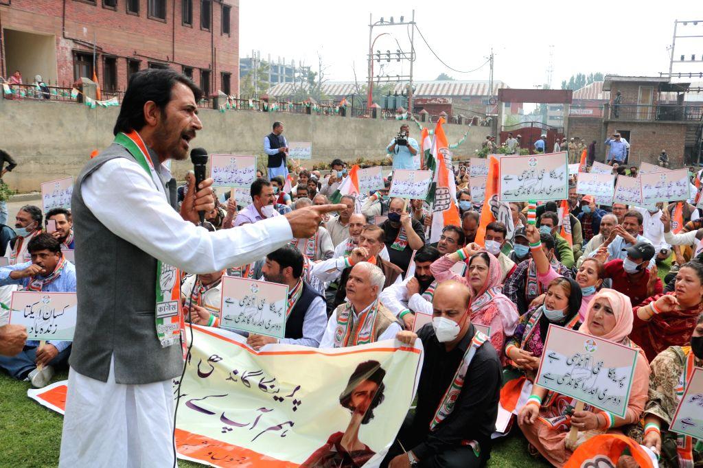 Srinagar: Jammu and Kashmir Pradesh Congress Committee (JKPCC) staged a protest against the arrest of senior Congress leader  Priyanka Gandhi in Uttar Pradesh and demanded the resignation of the Yogi government in Srinagar on Tuesday, October 05, 202 - Malik and Priyanka Gandhi