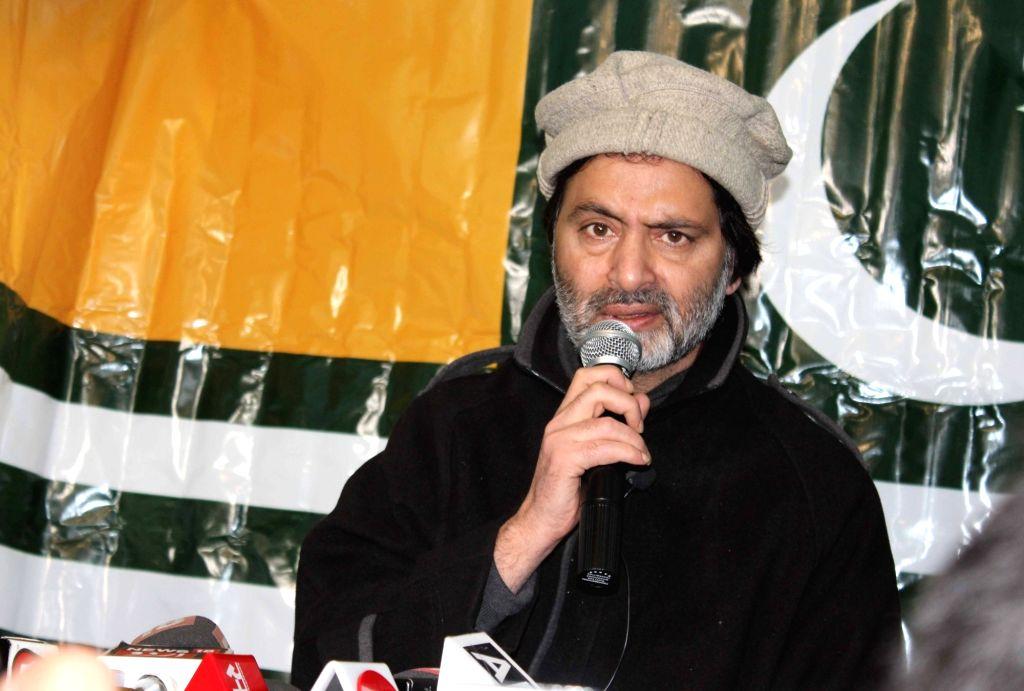 Srinagar: Jammu Kashmir Liberation Front (JKLF) chief Yasin Malik addresses a press conference in Srinagar on Feb 21, 2019. (Photo: IANS) - Malik