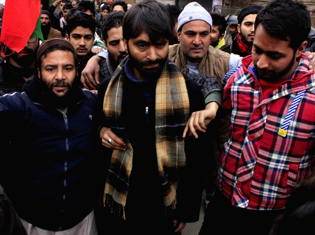 JKLF chairman Mohammad Yasin Malik participates in a rally after paying tribute to the victims of `Gawkadal massacre` in Srinagar, on Jan 21, 2015.