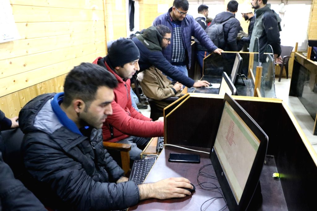 Srinagar: Journalists at a Government Media center in Srinagar, on Nov 21, 2019. Internet blockade in Kashmir since the abrogation of Article 370 on August 5 is causing unparalleled hardships to the people. Journalists in Kashmir who file their repor