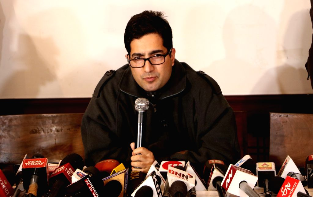 """Srinagar: Kashmiri IAS officer Shah Faesal, who quit IAS to protest against """"unabated killings"""" in Jammu and Kashmir, addresses a press conference in Srinagar, on Jan 11, 2019. Faesal, the first Kashmiri IAS topper, resigned from the civil service on"""