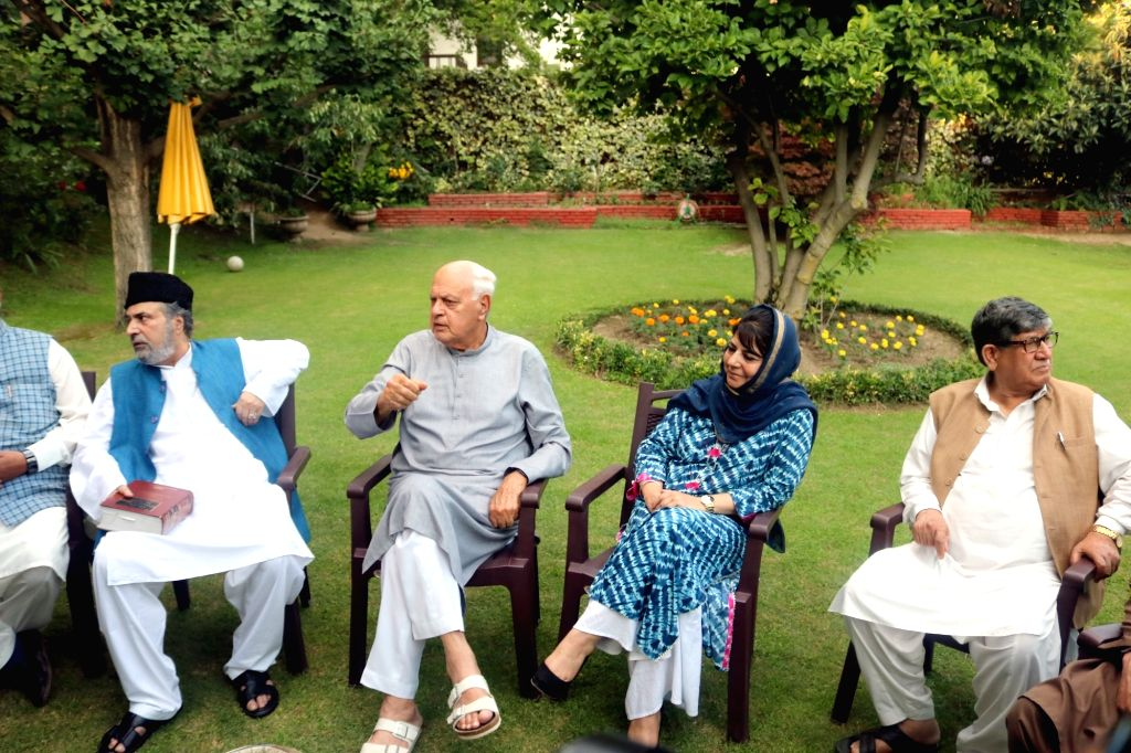 Srinagar: Peoples Democratic Party (PDP) leader Mehbooba Mufti and Nation Conference President Farooq Abdullah during All party meeting at Farooq Abdullah's residence in Srinagar on Aug 4, 2019. (Photo: IANS) - Mehbooba Mufti