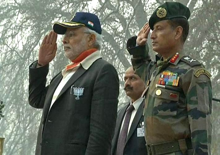 Prime Minister Narendra Modi pays tributes to the Jawans, at the Badamibagh headquarters of the Indian Army, in Srinagar, Jammu and Kashmir on Dec 8, 2014. - Narendra Modi
