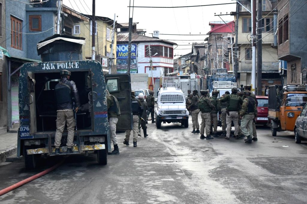 : Srinagar: Security beefed up at the site where a gun fight erupted between holed up militants and the security forces in Srinagar's Fateh Kadal area in which a policeman and three militants ...