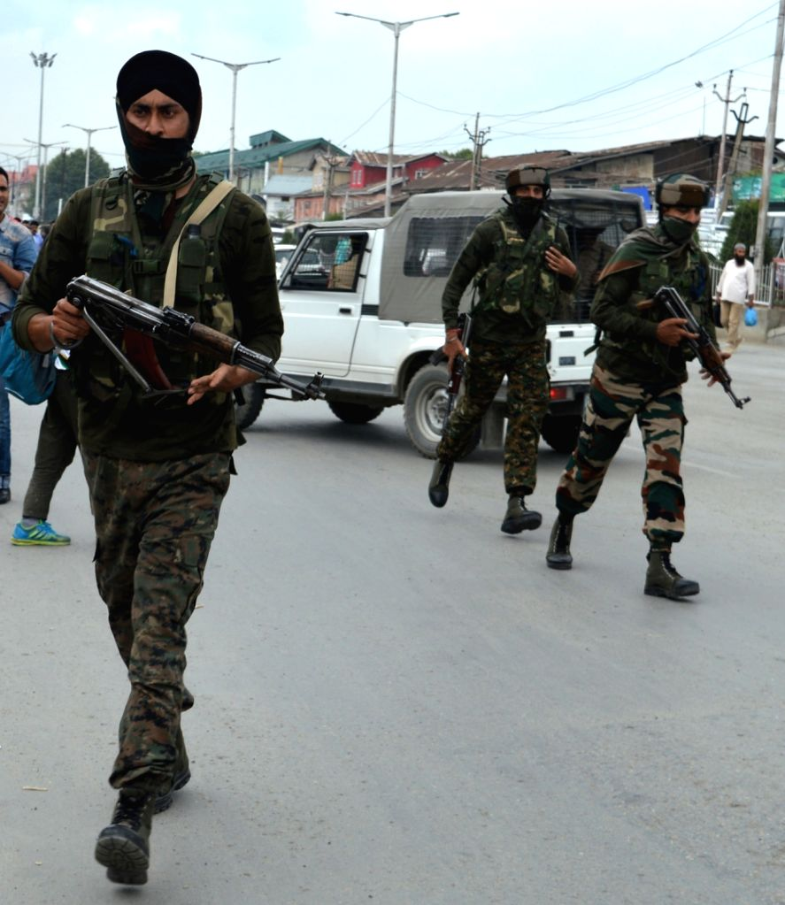:Srinagar: Security personnel conduct search operations after a CRPF trooper was killed in a militant attack, in Srinagar on July 24, 2018. Police said militants attacked a Central Reserve Police ...