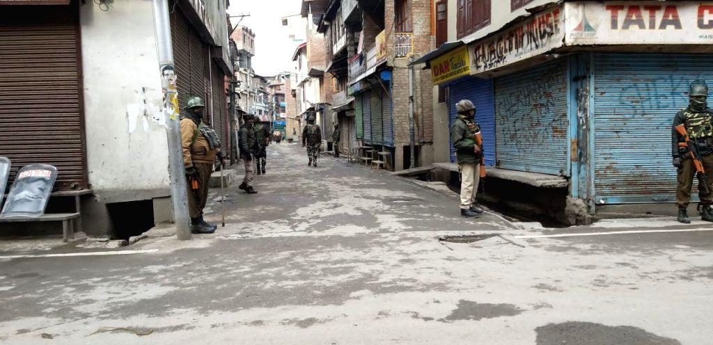 Srinagar: Security personnel deployed near the Srinagar residence of Jammu and Kashmir Liberation Front (JKLF) chairman Yasin Malik that was raided by National Investigation Agency (NIA) on Feb 26, 2019. (Photo: IANS) - Malik