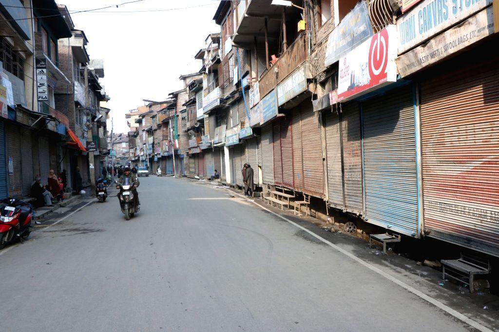 Srinagar: Shops remain closed in Srinagar to protest against attacks on Kashmiris in Jammu on Feb 16, 2019. (Photo: IANS)