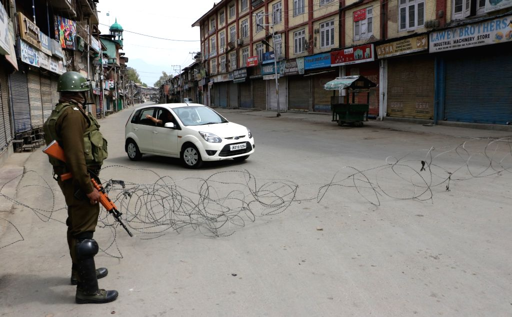 :Srinagar: Soldiers deployed on Srinagar streets as authorities imposed restrictions in parts of city to maintain law and order on April 6, 2018. (Photo: IANS).