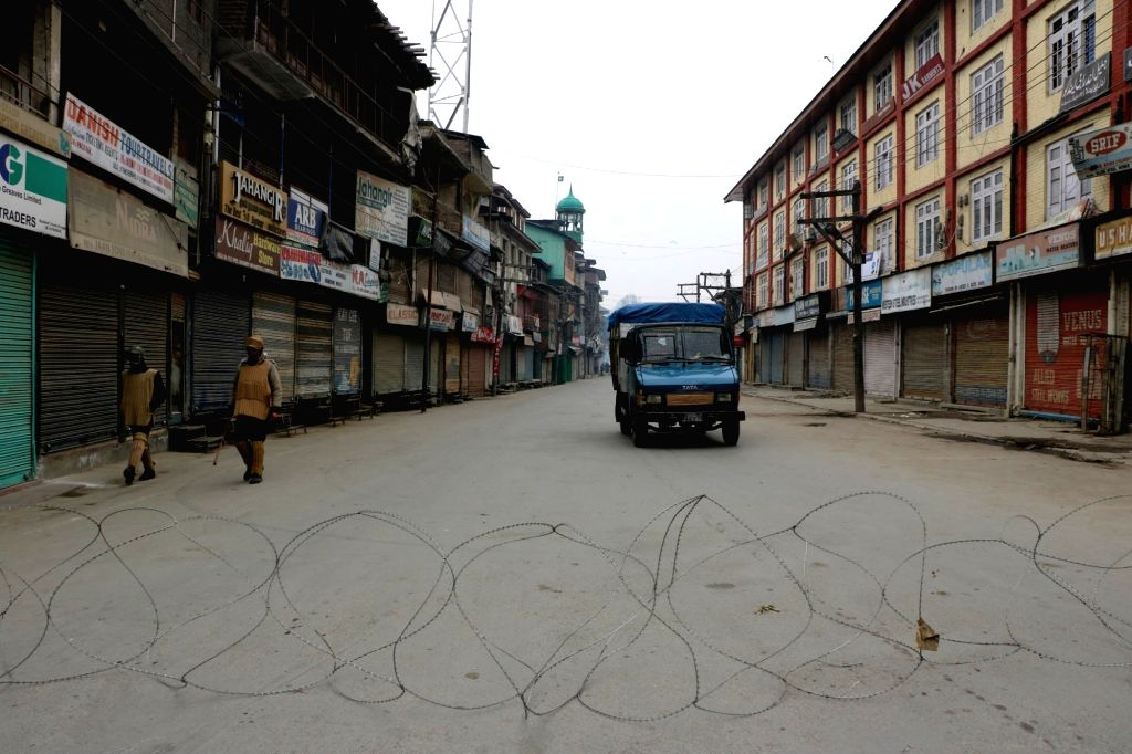 Srinagar: Streets of Srinagar wear a deserted look during a strike called by separatists to demand disbanding of Village Defence Committees (VDCs) in Jammu and Kashmir, on Dec 26, 2015. (Photo: IANS)