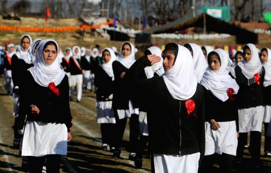 Students participate in Republic Day parade organised at Bakshi Stadium in Srinagar on Jan 26, 2015.