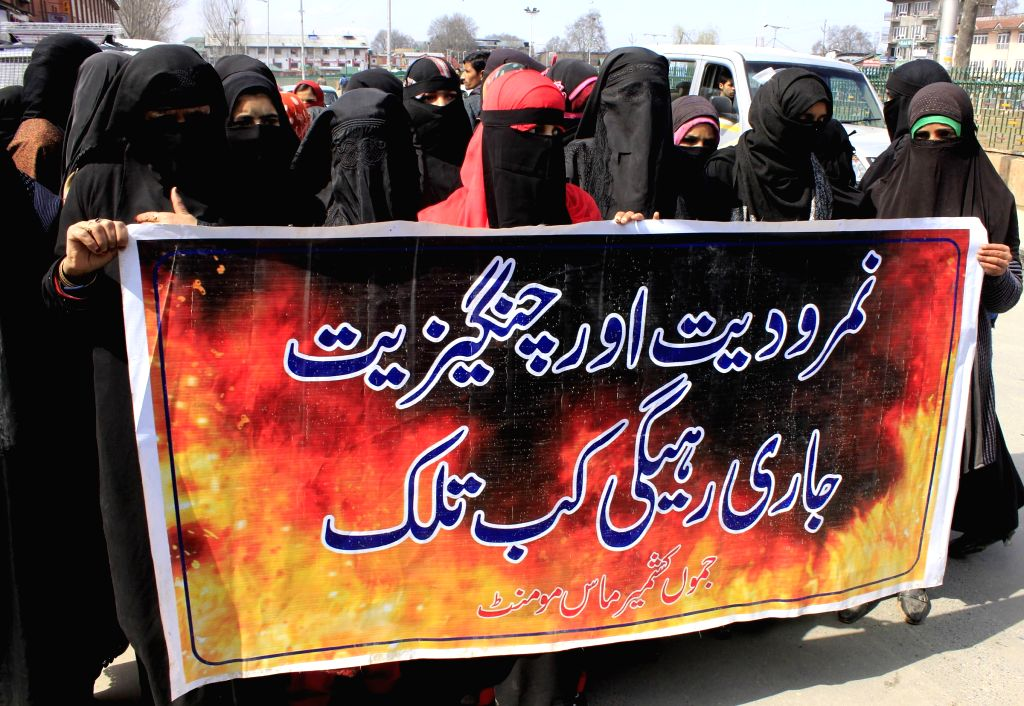 The activists of Jammu and Kashmir Mass Movement (JKMM) stage a demonstration to press for the release of all political prisoners in Kashmir, in Srinagar, on March 18, 2015.