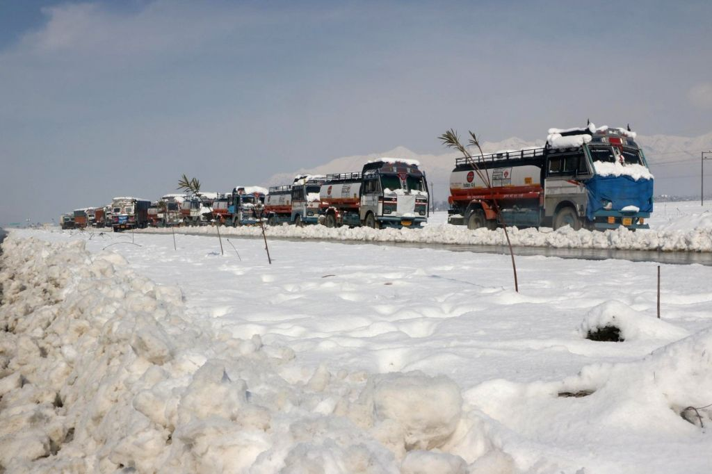 Srinagar: Trucks seen stranded on the Jammu-Srinagar highway after the strategic 300 km-long road remained closed for the third consecutive day due to heavy snowfall and landslides, on Feb 8, 2019. (Photo: IANS)
