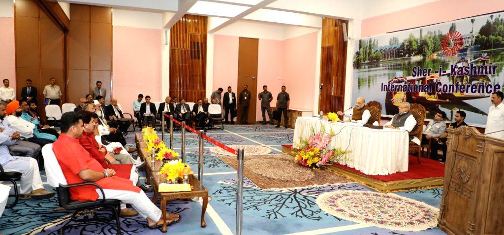 Srinagar: Union Home Minister Amit Shah accompanied by Jammu and Kashmir Governor Satya Pal Malik, meets a delegation of Sarpanches-village heads, in Srinagar on June 27, 2019. (Photo: IANS/PIB) - Amit Shah and Malik