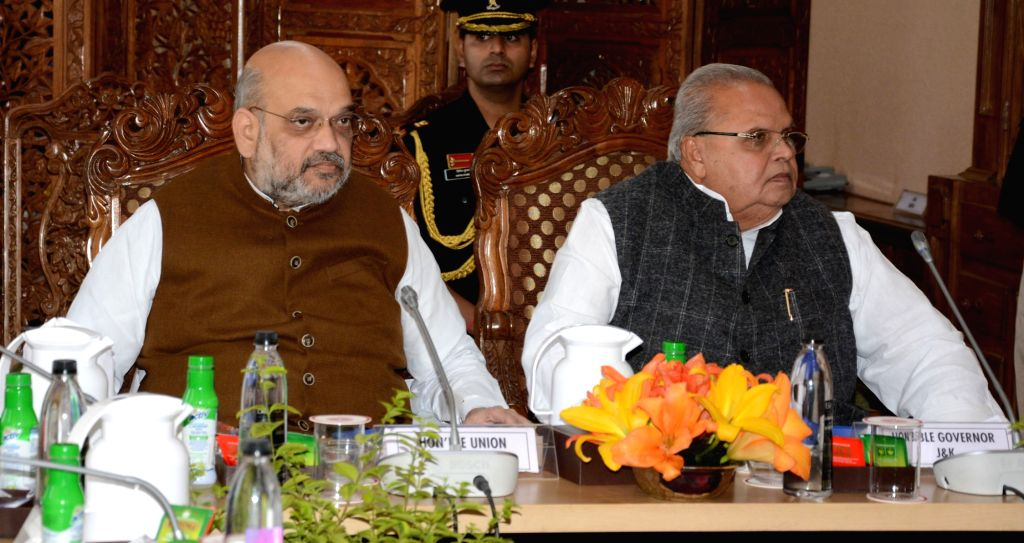 Srinagar: Union Home Minister Amit Shah and Jammu and Kashmir Governor Satya Pal Malik chair a review meeting on security and law and order situation in Srinagar on June 27, 2019. (Photo: IANS/PIB) - Amit Shah and Malik