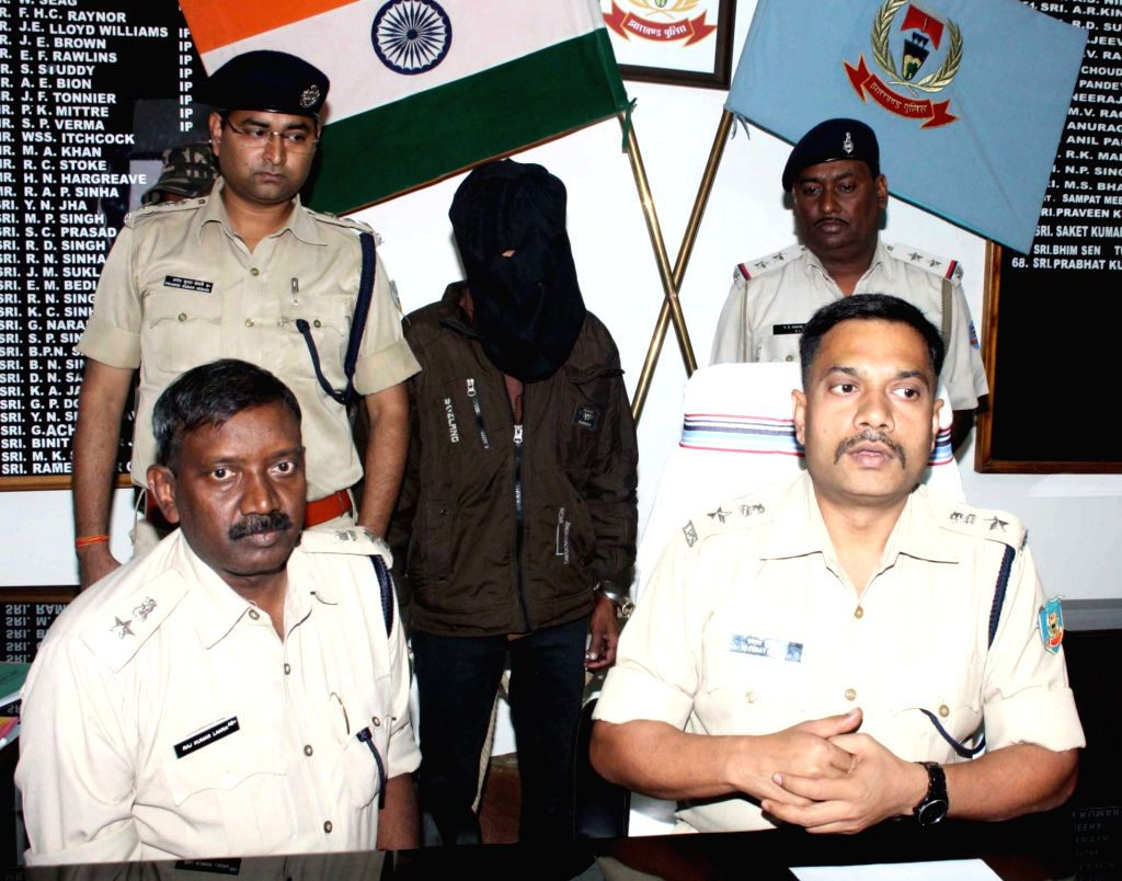 SSP Prabhat Kumar (R) with SP Raj Kumar Lakra addresses a press conference regarding People Liberation Front of India (PLFI) area commander Arun Yadav arrest from Budhmu Village near Ranchi ... - Prabhat Kumar and Kumar Lakra