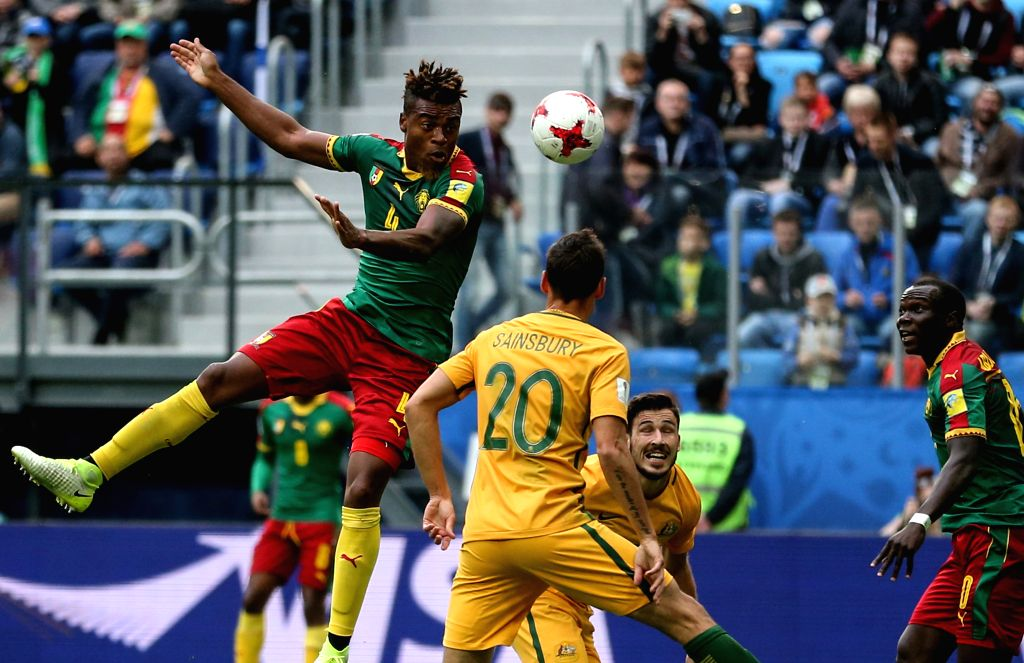 ST.Adolphe Teikeu (Top) of Cameroon heads the ball to shoot during the group B match between Cameroon and Australia at the 2017 FIFA Confederations Cup in St. ...