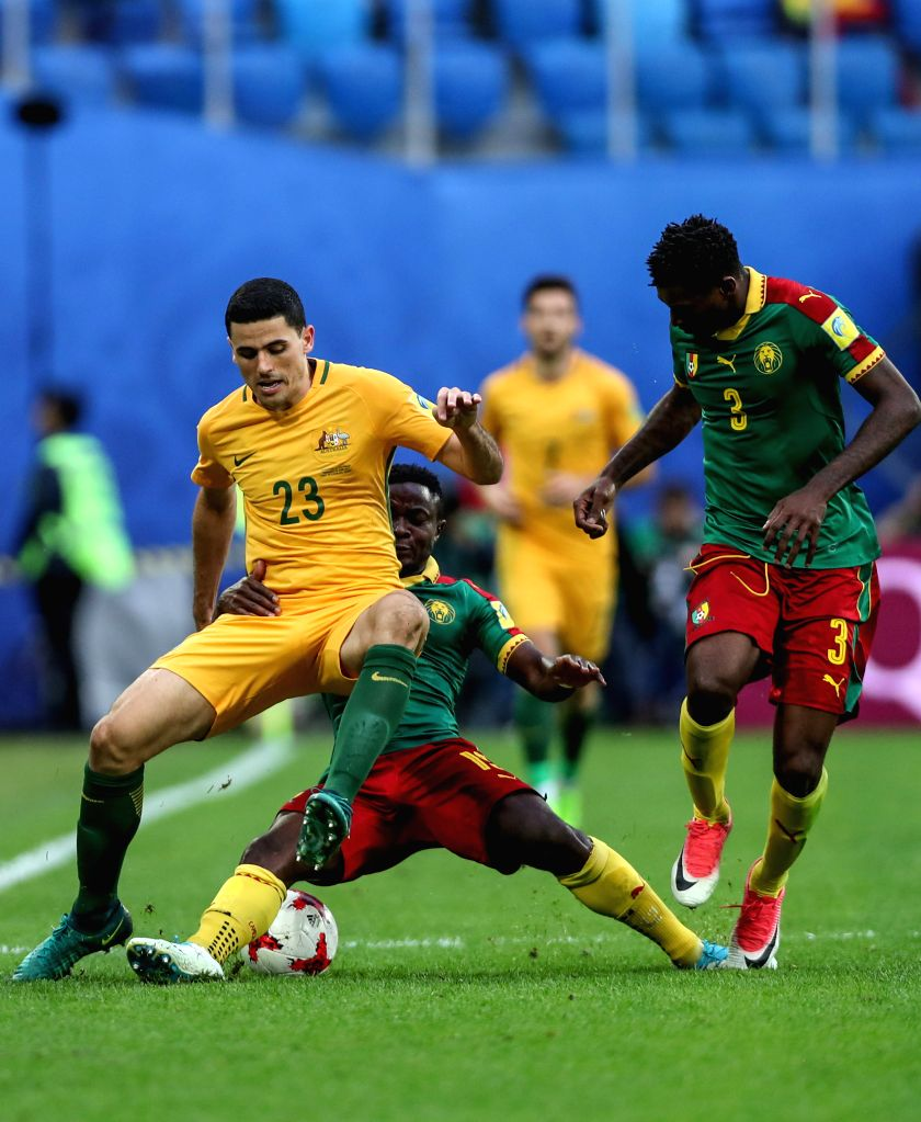 ST.Collins Fai (C) of Cameroon vies with Tommy Rogic (L) of Australia during the group B match between Cameroon and Australia at the 2017 FIFA Confederations ...