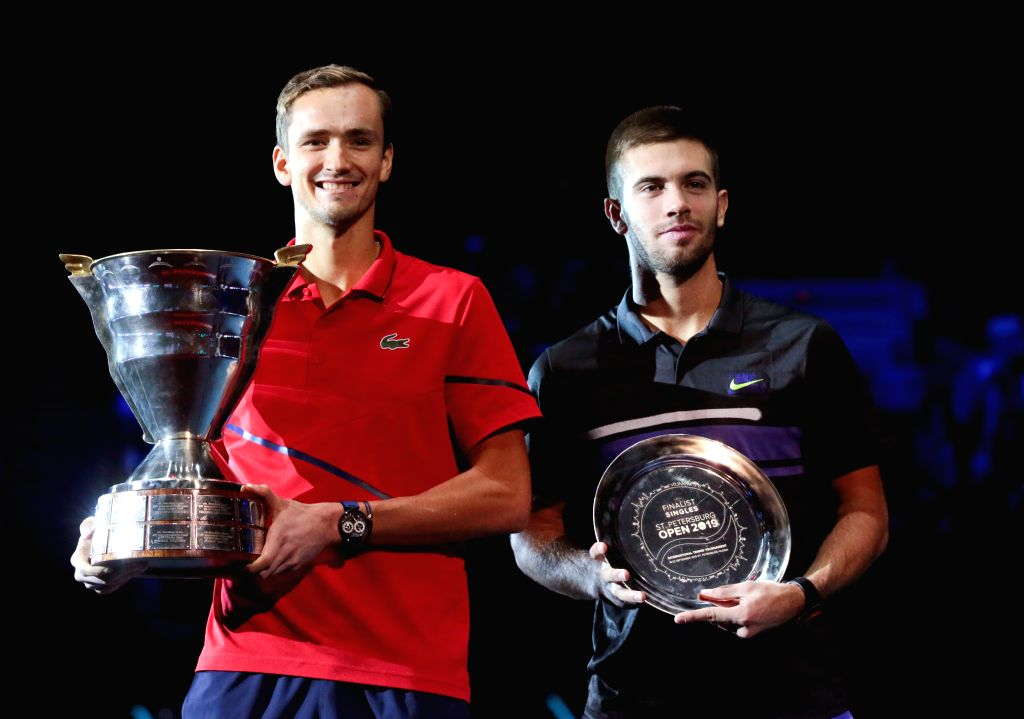 ST.Daniil Medvedev (L) of Russia and Borna Coric of Croatia pose with the trophies during the awarding ceremony after the final match at St. Petersburg Open ...