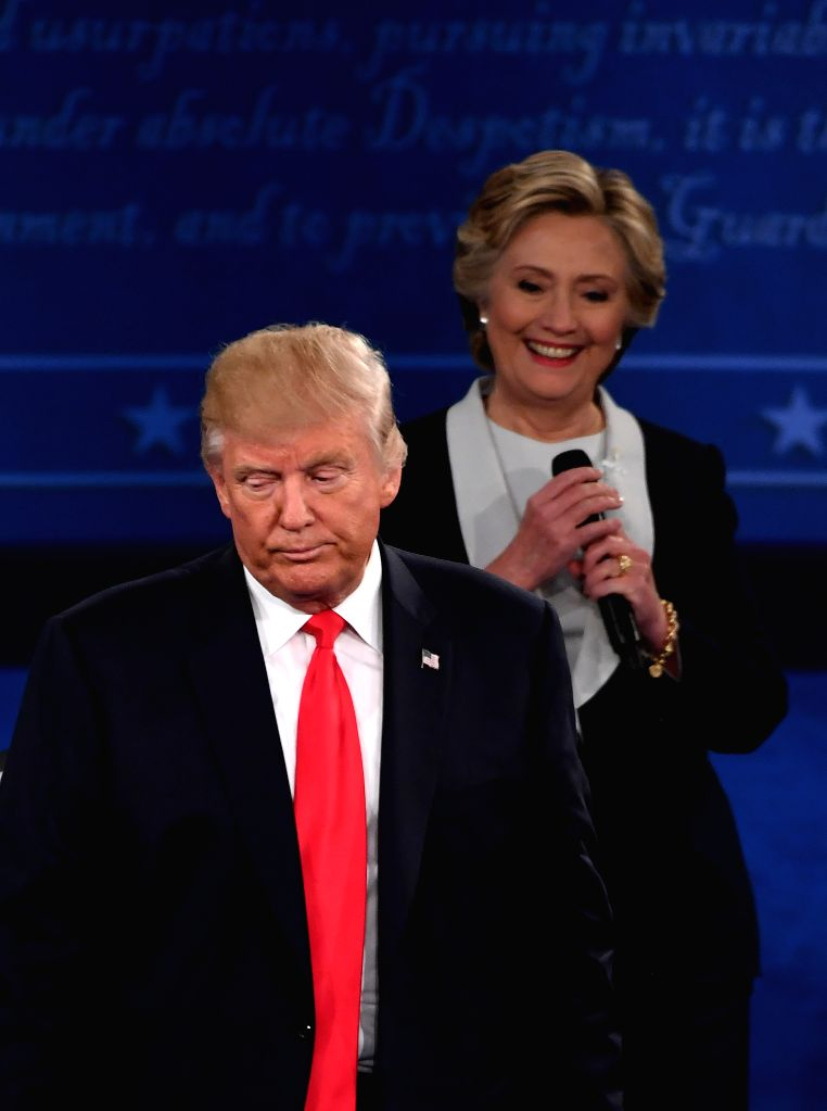 ST.Democratic presidential candidate Hillary Clinton (R) and Republican presidential candidate Donald Trump attend the second presidential debate at Washington ...