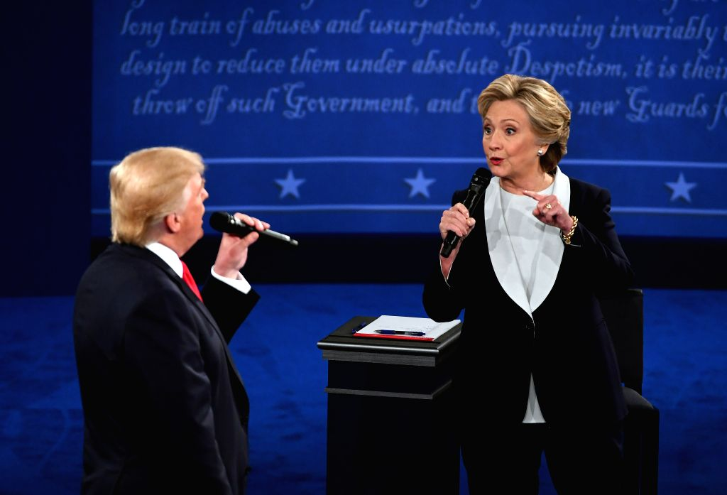ST.Democratic presidential candidate Hillary Clinton (R) and Republican presidential candidate Donald Trump hold the second presidential debate at Washington ...