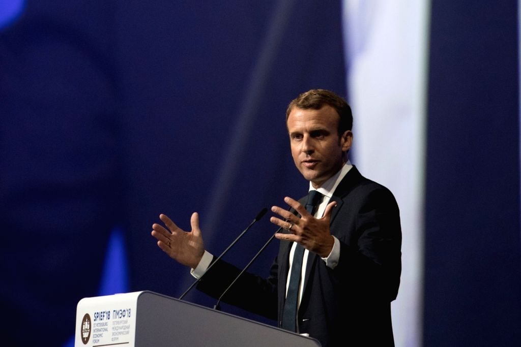 ST.French President Emmanuel Macron addresses a plenary session during the 22nd St. Petersburg International Economic Forum (SPIEF) in St. Petersburg, May 25, ...