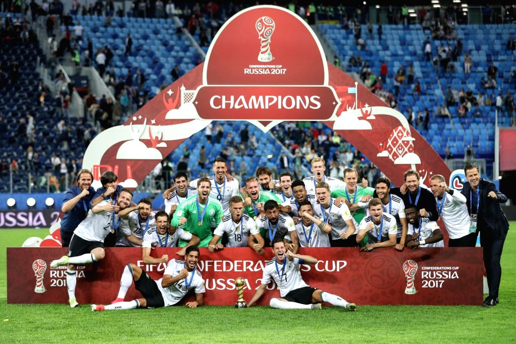 ST.German players pose for photos during the awarding ceremony after the final match between Chile and Germany at the 2017 FIFA Confederations Cup in St. ...