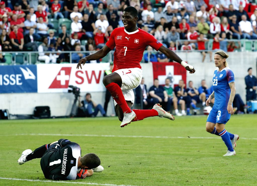 ST.Iceland's goalkeeper Hannes Halldorsson (L) saves a ball from Switzerland's Breel Embolo during during the UEFA Nations League group A2 match between Switzerland ...