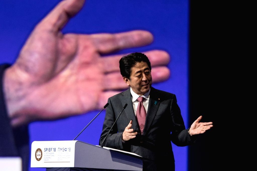 ST. Japanese Prime Minister Shinzo Abe addresses a plenary session during the 22nd St. Petersburg International Economic Forum (SPIEF) in St. Petersburg, May 25, ... - Shinzo Abe