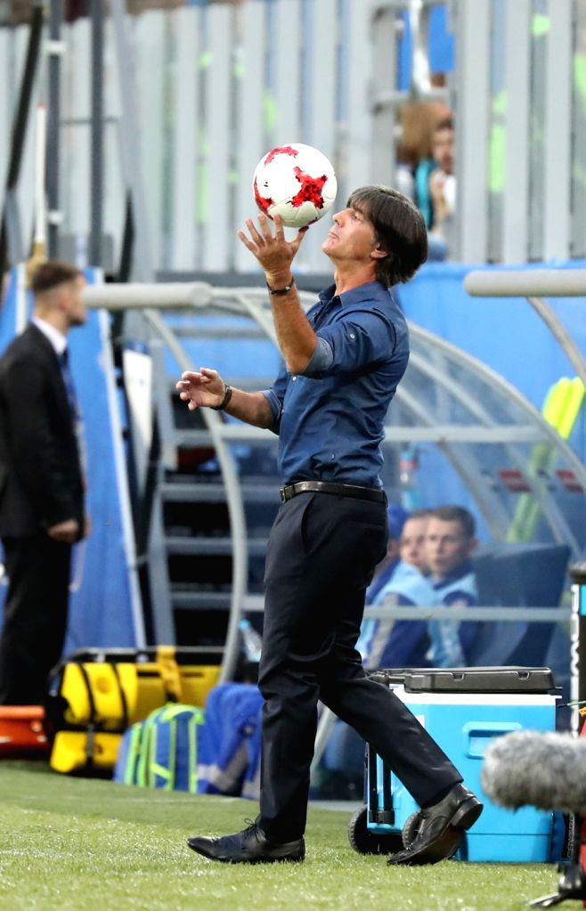 ST.Joachim Loew, head coach of Germany, catches the ball during the final match between Chile and Germany at the 2017 FIFA Confederations Cup in St. Petersburg, ...