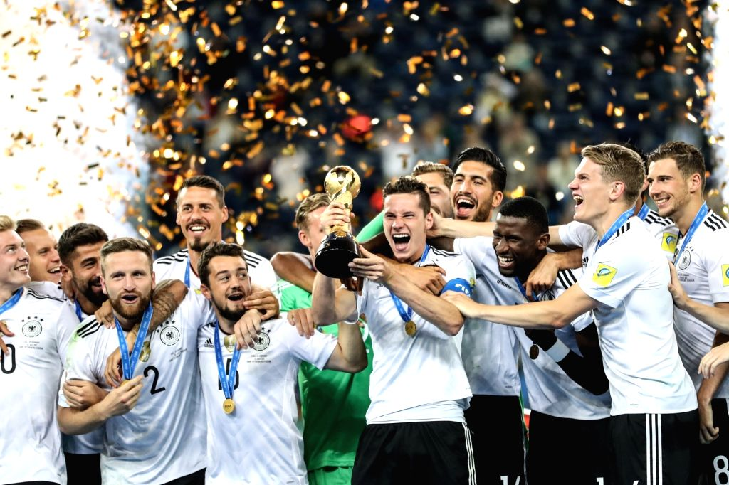 ST.Julian Draxler of Germany holds the trophy during the awarding ceremony after the final match between Chile and Germany at the 2017 FIFA Confederations Cup in ...