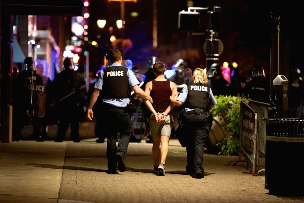 ST. LOUIS (U.S.), Sept. 18, 2017 A protester is arrested in St. Louis, Missouri, the United States, Sept. 17, 2017. Protesters smashed windows and other property in downtown St. Louis, ...