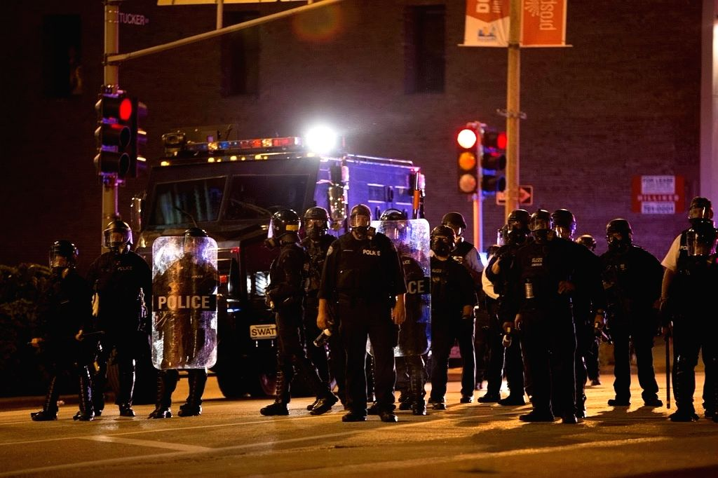 ST. LOUIS (U.S.), Sept. 18, 2017 Police officers stand guard in St. Louis, Missouri, the United States, Sept. 17, 2017. Protesters smashed windows and other property in downtown St. ...