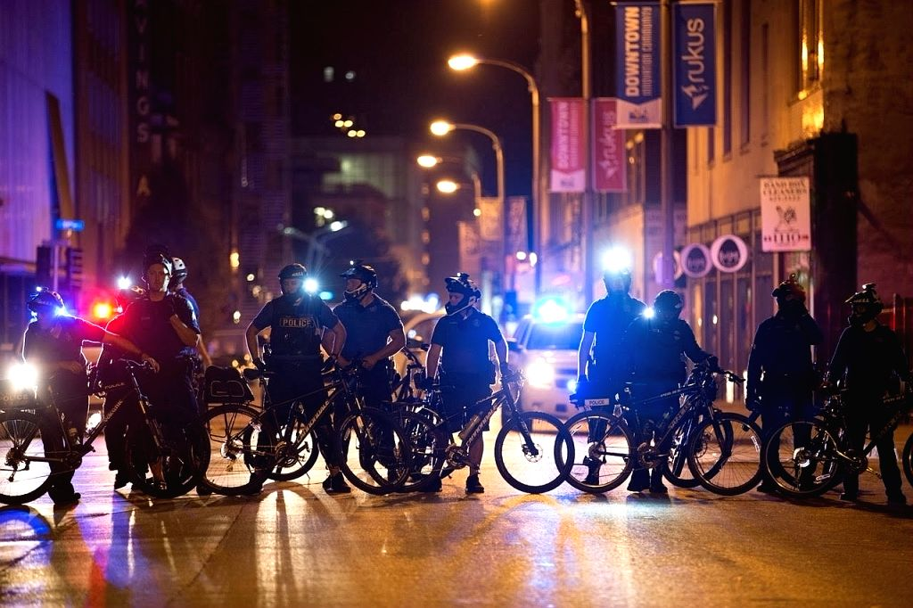 ST. LOUIS (U.S.), Sept. 18, 2017 Police officers use bikes to block a street in St. Louis, Missouri, the United States, Sept. 17, 2017. Protesters smashed windows and other property in ...