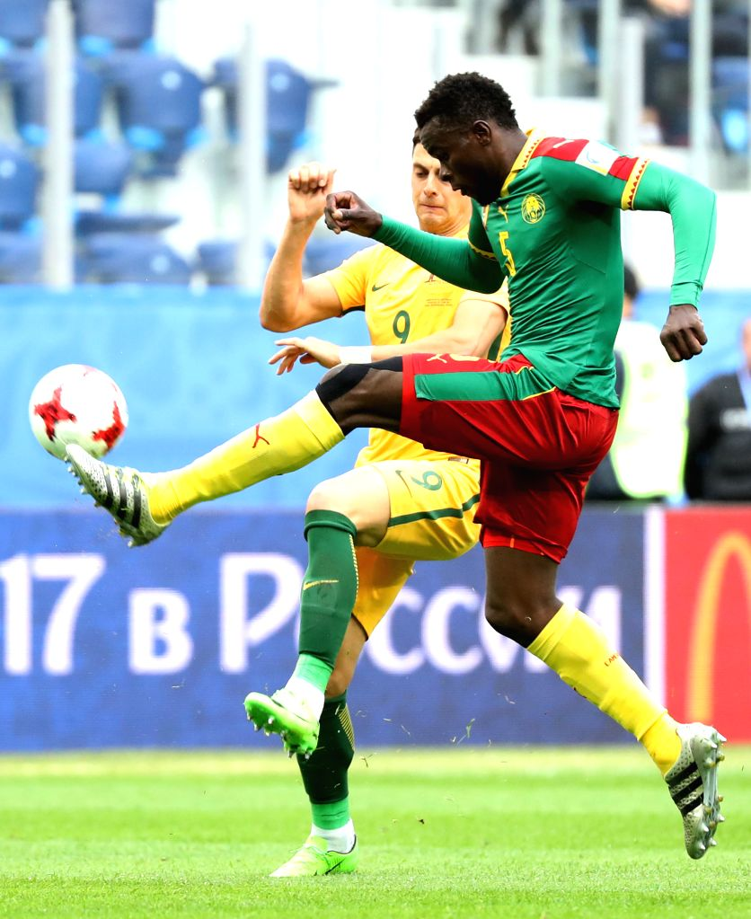 ST.Michael Ngadeu-Ngadjui (R) of Cameroon vies with Tomi Juric of Australia  during the group B match between Cameroon and Australia at the 2017 FIFA ...