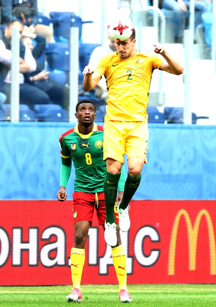 ST.Milos Degenek (R) of Australia heads the ball during the group B match between Cameroon and Australia at the 2017 FIFA Confederations Cup in St. Petersburg, ...