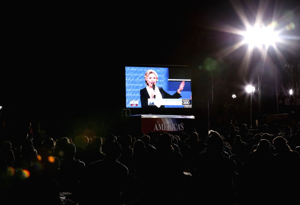 ST.People watch live broadcast of the 2016 presidential debate at Washington University in St. Louis, Missouri, the United States, Oct. 9, 2016. The second of three ...