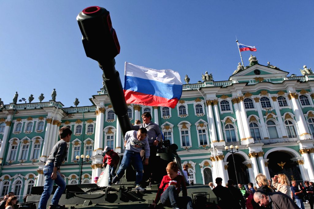 ST.People celebrate the National Flag Day in front of the Winter Palace in St. Petersburg, Russia, Aug. 22, 2014.