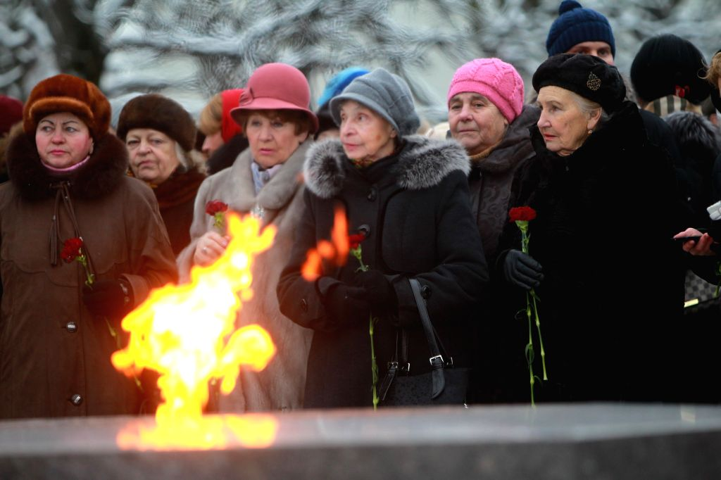 ST.People attend a ceremony to mark the 71st anniversary of the end of the Leningrad Blockade at the Piskaryovskoye Memorial Cemetery in St. Petersburg, Russia,