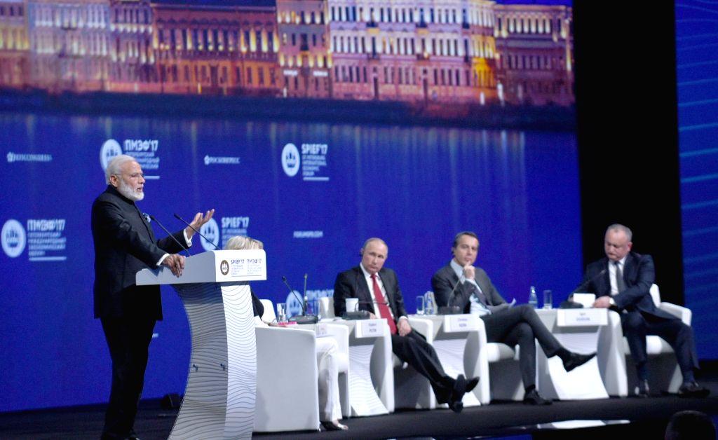 St. Petersburg: Prime Minister Narendra Modi addresses at the plenary session of St. Petersburg International Economic Forum (SPIEF2017) in St. Petersburg, Russia on June 2, 2017. Also seen Russian ... - Narendra Modi