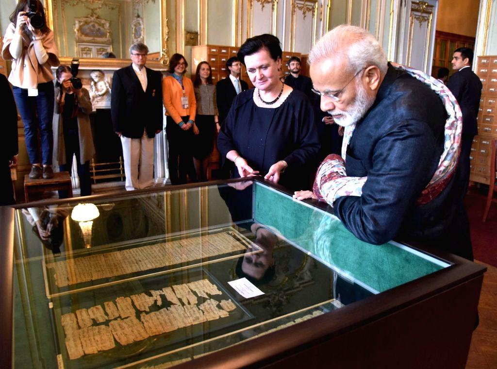 St. Petersburg: Prime Minister Narendra Modi visits the Institute of Oriental Manuscripts, in St. Petersburg, Russia on June 2, 2017. - Narendra Modi