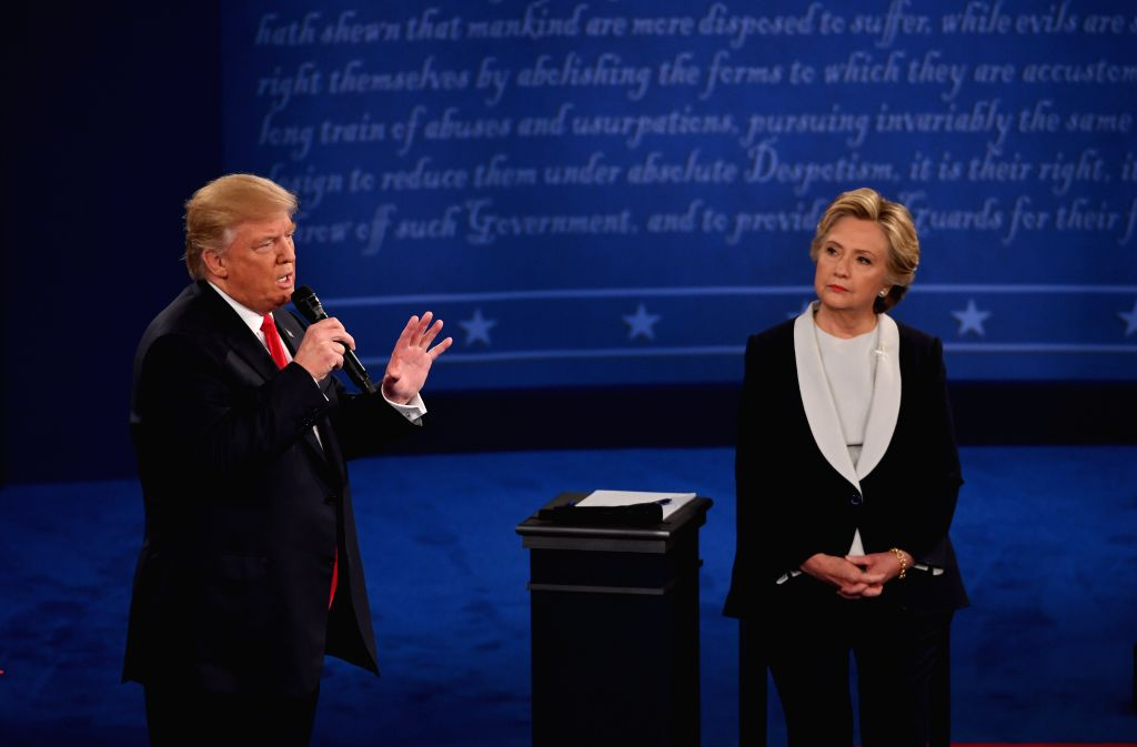 ST.Republican presidential candidate Donald Trump (L) and Democratic presidential candidate Hillary Clinton participate in the second presidential debate at ...