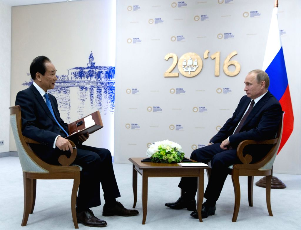 ST.Russian President Vladimir Putin (R) is interviewed by President of Xinhua News Agency Cai Mingzhao in St.Petersburg of Russia, June 17, 2016. Russian ...