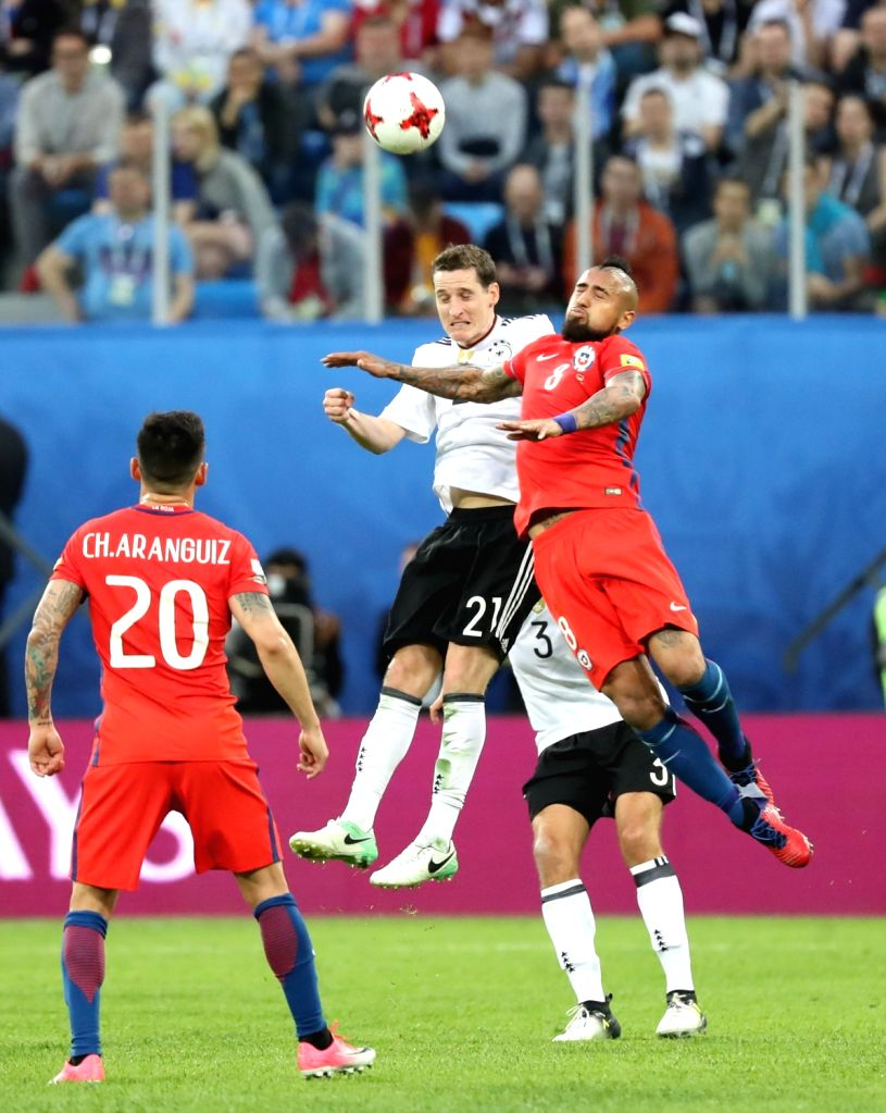ST.Sebastian Rudy (2nd L) of Germany vies with Arturo Vidal (1st R) of Chile during the final match between Chile and Germany at the 2017 FIFA Confederations Cup ...